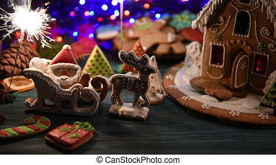 Gingerbread house with lights on dark background, xmas theme