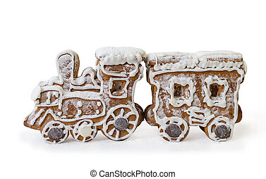 Gingerbread in the form of a New Year's cortege with white glaze on a steam locomotive.