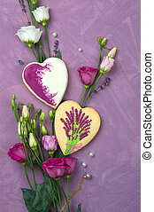 gingerbread in the shape of a heart on a lilac background with flowers