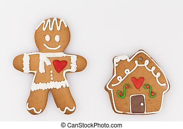 gingerbread man and a house with a pipe