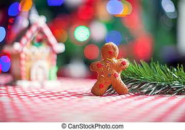 Gingerbread man background candy ginger house and Christmas tree lights