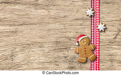 Gingerbread man on a wooden background