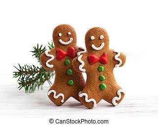 Gingerbread men - Smiling gingerbread men on white wooden...