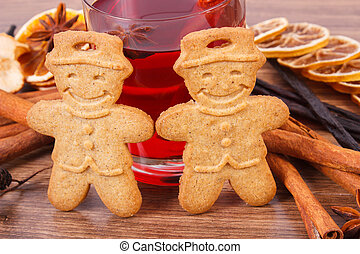 Gingerbread or Christmas cookies, glass of mulled wine and spices