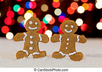 Gingerbread people with blurry christmas lights