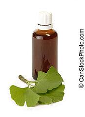 Gingko Drops - Medicine flask and gingko leaves - isolated ...