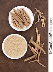 Ginseng ashwagandha herb root and powder over handmade lokta...