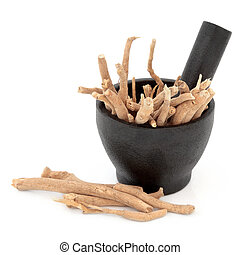 Ginseng herbal medicine in a mortar with pestle over white...