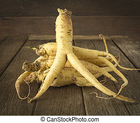ginseng - Ginseng root is placed on the wooden floor; Herbal...