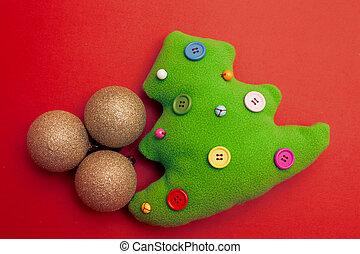 giocattolo, albero natale, su, sfondo rosso