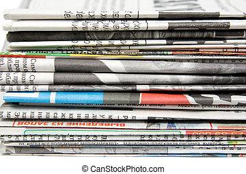 giornali, pila