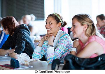 giovane, carino, femmina, studente università, seduta, in, uno, aula