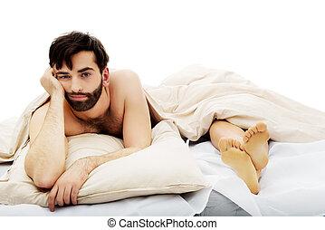 giovane, depresso, uomo, in, bed.