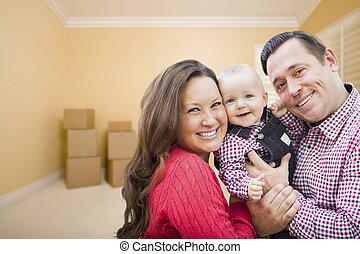 giovane famiglia, in, stanza, con, spostamento, scatole