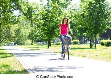 giovane, guida bici