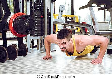 giovane, push-ups, palestra, uomo