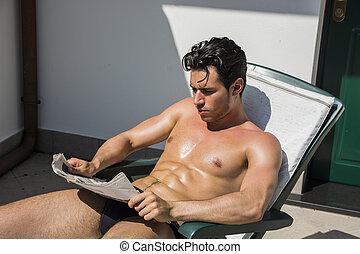 giovane, salotto, giornale, sedia, lettura, uomo