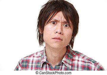 giovane, uomo giapponese, umore difettoso