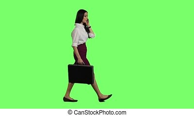 Gir talk on the phone and runs. Green screen. Slow motion