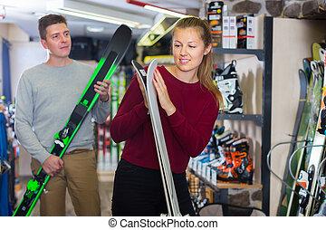 gir with man are choosing ski