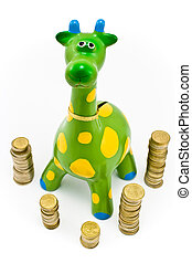 Giraffe money-box surrounded by towers of the coines