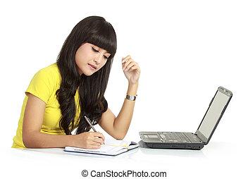 girl, à, ordinateur portable, et, écrire, sur, a, livres