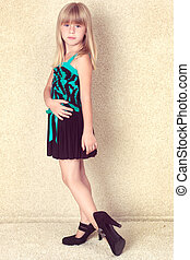 girl 5 years old in big shoes with heels