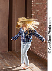 Girl 6 years old in jeans  dancing