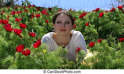 Girl About Peonies - Beautiful girl lying on the field of...
