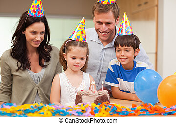 Girl about to blow out the candles on her birthday cake