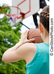 Girl about to shoot basketball