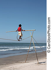 acrobat - girl acrobat sea sky waves rope acrobat with a ...