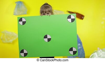 Girl activist holding chroma key poster with tracking points. Environment trash plastic pollution