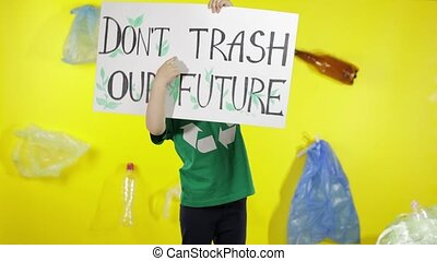 Girl activist holding poster Don't Trash Our Future. Reduce nature pollution. Save environment