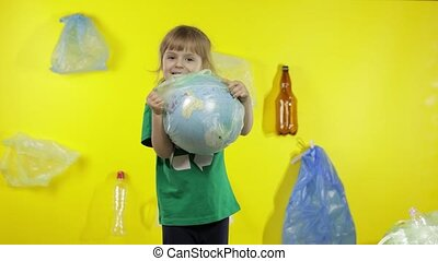 Girl activist tries to free Earth globe from plastic package. Reduce trash pollution. Save ecology