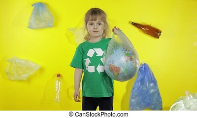 Girl activist with Earth globe in plastic package. Reduce nature pollution. Save ecology environment