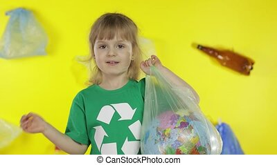 Girl activist with Earth globe in plastic package. Reduce trash pollution. Save ecology environment