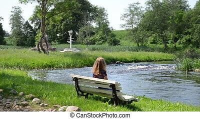 girl admire nature - beautiful woman sitting on a white...
