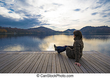 girl admiring lake