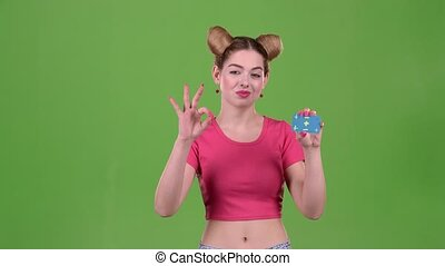 Girl advertises a card and shows a ok. Green screen - Girl...