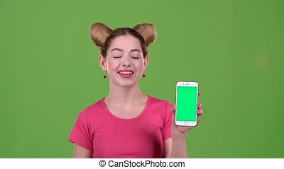 Girl advertises the phone. Green screen. Slow motion