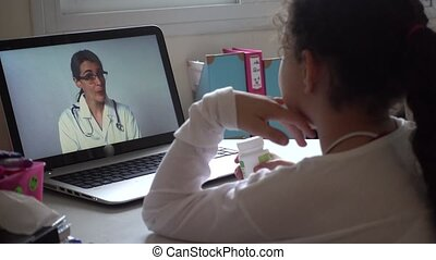 Girl advise with her doctor via telemedicine program - Girl...