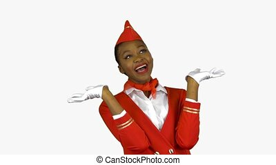 Girl afro american dressed in red rejoices in victory, she became a flight attendant. Alpha channel
