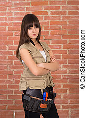 girl against a brick wall