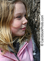 Girl Against a Tree