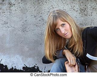 Girl against grunge wall