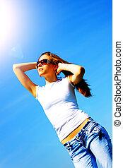 Girl against the blue sky