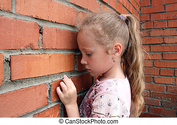 girl against the wall