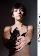 Girl aiming a , focus on the gun