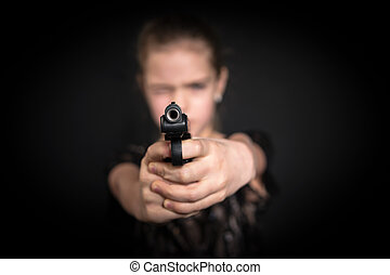 Girl aims with a gun